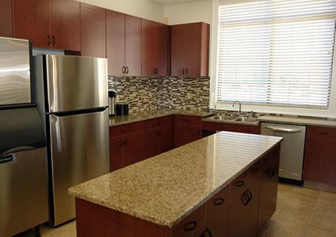 Catering Kitchen with stainless steel appliances and granite countertops